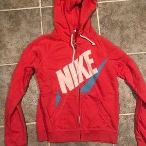 Pink/red Nike zip up sweatshirt